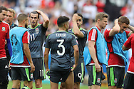 Gareth Bale (11) and Hal Robson-Kanu of Wales (9) look on dejected at the end of match after their team loses.  Euro 2016, group B , England v Wales at Stade Bollaert -Delelis  in Lens, France on Thursday 16th June 2016, pic by  Andrew Orchard, Andrew Orchard sports photography.