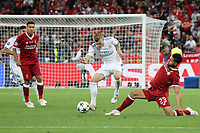 KIEV, UKRAINE - MAY 26: Ere Can of Liverpool tackles Toni Kroos of Real Madrid during the UEFA Champions League final between Real Madrid and Liverpool at NSC Olimpiyskiy Stadium on May 26, 2018 in Kiev, Ukraine. (MB Media)
