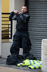 © under license to London News Pictures. 29/01/2011.A policeman dressing in armor during more student demonstrations today (29/01/2011). Thousands of students took to the streets of London and Manchester to protest against cuts to education. Photo credit should read: London News Pictures