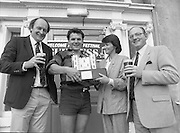 """Guinness Festival of Champions (Rugby).1986..06.09.1986..09.06.1986..6th September 1986..At Guinness,St James' Gate on 1/9/86 it was announced that a Festival of Champions (Rugby), would be held at Stradbrook,Dublin. The event was launched by Irish International Coach,Mr Mick Doyle,Mr Andrew Butler,President,Blackrock RFC,Mr Michael Dunne,Regional Sales Manager,Guinness Group Sales and Mr Fergus Slattery,Irish international...Photograph  shows Mrs Laura Butler,wife of Mr Andy Butler (far left),President,Blackrock College RFC presenting the """"Castle Trophy"""" to winning captain Mr Willie Burns. Mr Michael Dunne,Regional Manager,Guinness Group Sales completes the picture..Mr Burns captained Lansdowne RFC to victory in the 'Guinness Blackrock Festival Of Champions'."""