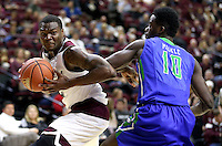 Texas A&M's Jalen Jones (12) drives the basket against Florida Gulf Coast University's Kevin Mickle (10) during a NCAA college basketball game in College Station, Texas, Wednesday, Dec. 2, 2015.  (AP Photo/Sam Craft)