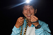 Professor Ming-Chung Tu, with Yellow-lipped or Banded Sea krait, (Laticaudata colubrina), SanXianTai/ San-Hsien-T'ai Island, Chenggong township, Taiwan