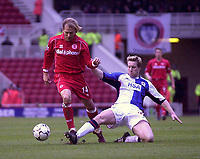Photo. Glyn Thomas.<br /> <br /> Middlesbrough v Blackburn Rovers. Premiership. <br /> <br /> Riverside Stadium, Middlesbrough. 07/02/2004.<br /> <br /> Boro's Gaizka Mendieta (L) is tackled by Andy Todd.