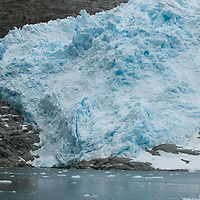 A glacier icefall empties into Seno Chico (Small Fjord) in Alberto de Agostini National Park, Tierra del Fuego, Chile.
