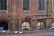 Waste pipes on the exterior of a building in Balsall Heath on 24th November 2020 in Birmingham, United Kingdom.