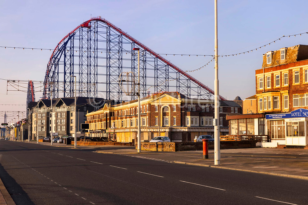 An empty Golden Mile, with the Blackpool Pleasure Beach ride The Big One towering over the housing, closed during the pandemic on 21st April 2021 in Blackpool, Lancashire, United Kingdom. Blackpool is a large town and seaside resort in the county of Lancashire on the north west coast of England. Blackpool was once a booming resort with it's famous promenade which now, despite having a somewhat shabby appearance, still continues to attract millions of visitors each year. During the coronavirus pandemic however, Blackpool has struggled, with empty streets and closed down businesses creating an atmosphere more like a ghost town.
