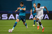 SAINT-PETERSBURG, RUSSIA - OCTOBER 20: Sardar Azmoun of Zenit St Petersburg and Clinton Mata of Club Brugge KV in action during the UEFA Champions League Group F match between Zenit St Petersburg and Club Brugge KV at Gazprom Arena on October 20, 2020 in Saint-Petersburg, Russia [Photo by MB Media]