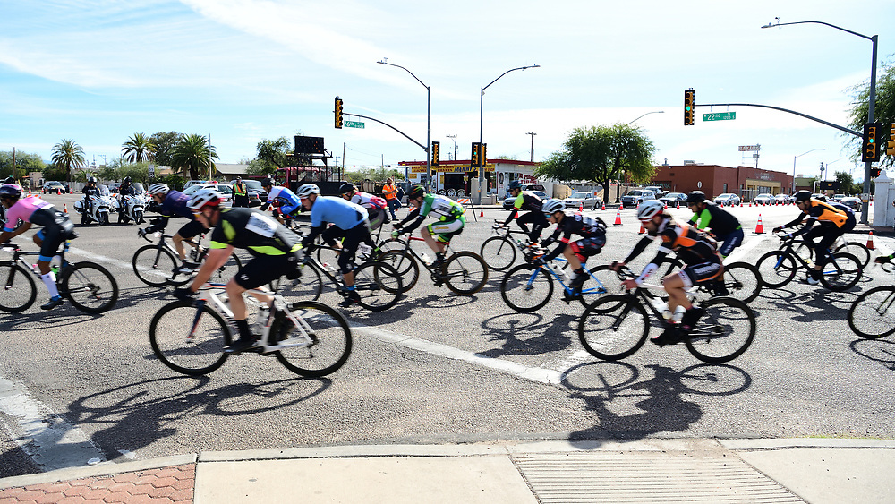 El Tour de Tucson 2019 finishers rounding the race's final corner at 22nd Street and 6th Avenue. Bike-tography by Martha Retallick.