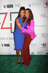 Naomi Campbell and Iman at Fashion 4 Development's 7th Annual First Ladies Luncheon in New York City.