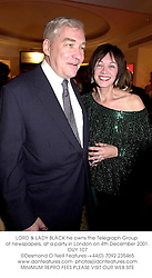 LORD & LADY BLACK he owns the Telegraph Group of newspapers, at a party in London on 4th December 2001.	OUY 107