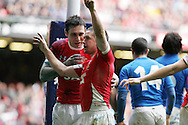 Shane Williams of Wales gets a congratulation from Stephen Jones  after Williams scores his try.  RBS Six nations championship 2010, Wales v Italy at the Millennium Stadium in Cardiff  on Sat 20th March 2010. pic by Andrew Orchard, Andrew Orchard sports photography,