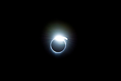 Thediamond-ringeffect is seen during a total solar eclipse on Monday, August 21, 2017 from onboard a NASA Gulfstream III aircraft flying 25,000 feet above the Oregon coast. As the last bits of sunlight pass through the valleys on the moon's limb, and the faint corona around the sun is just becoming visible, it looks like aringwith glitteringdiamondson it. Credit: (NASA/Carla Thomas)