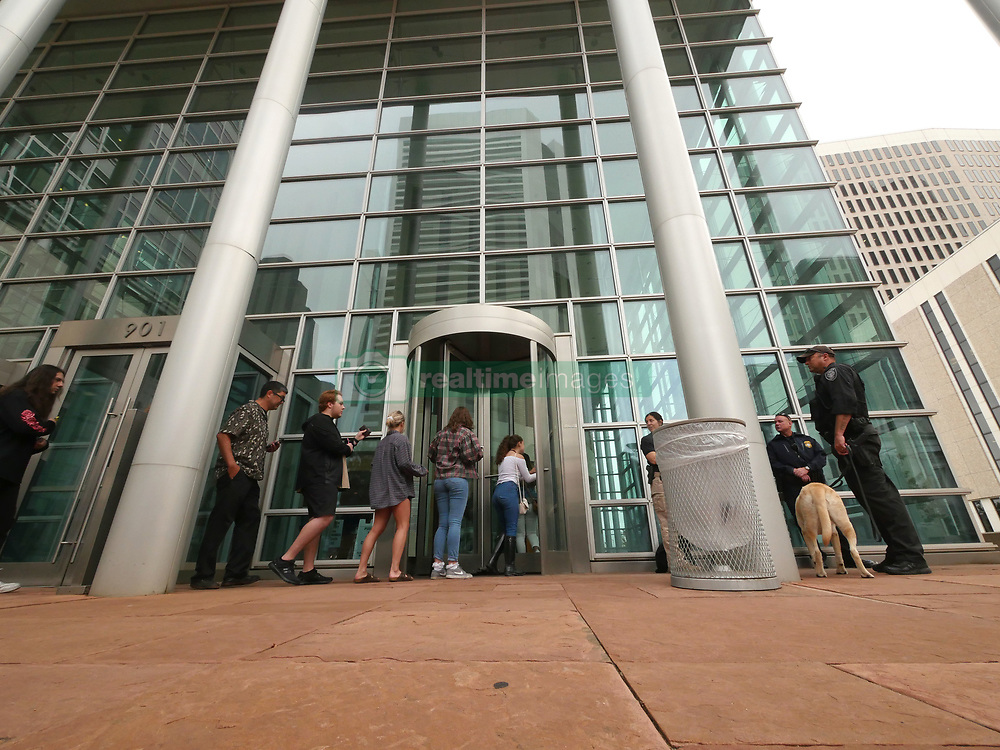 August 8, 2017 - Denver, Colorado, U.S - People who had been waiting in line enter the courthouse for at the Taylor Swift Groping Trial against radio DJ David Mueller at the Alfred A. Arraj United States Courthouse in Denver, Colorado, U.S., on Tuesday, August 8, 2017. (Credit Image: © Matthew Staver via ZUMA Wire)
