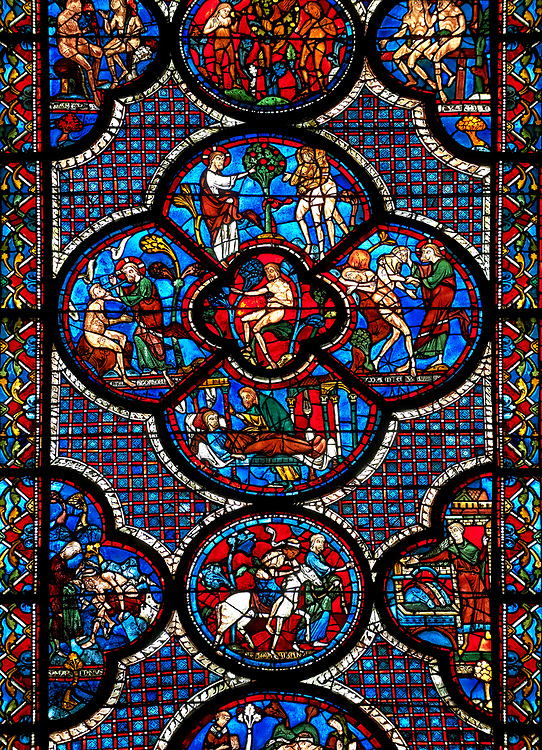 Medieval stained glass Window of the Gothic Cathedral of Chartres, France - dedicated to the lGood Samaritan . Central panel shows Adam dwelling in Paradise, below - At the inn, the Samaritan nurses the injured man back to health, left - God breathing life into Adam, above - God warning Adam and Eve not to eat from the tree of knowledge, right - God creates Eve out of Adam's rib . bottom central oval panel - The Samaritan leading the Pilgrim to an inn, left of this - A Samaritan binds the injured man's wounds, right of centre - An innkeeper welcoming the Samaritan.  A UNESCO World Heritage Site.. .<br /> <br /> Visit our MEDIEVAL ART PHOTO COLLECTIONS for more   photos  to download or buy as prints https://funkystock.photoshelter.com/gallery-collection/Medieval-Middle-Ages-Art-Artefacts-Antiquities-Pictures-Images-of/C0000YpKXiAHnG2k