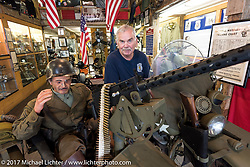 "Retired Harford, CT police officer and American Police Motorcycle museum founder Doug Frederick sits on his 1942 Canadian military ( (the only allied WW2 force to use sidecars) Harley-Davidson 45"" WLA with 30 cal machine gun. The museum opened in 2010 in this 1800's barn. Laconia Motorcycle Week, New Hampshire, USA. Saturday June 17, 2017. Photography ©2017 Michael Lichter."