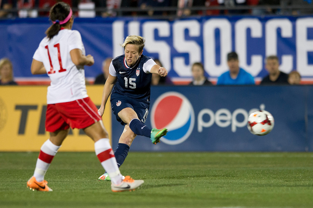 FRISCO, TX - JANUARY 31:  Megan Rapinoe #15 of the U.S. Women's National Team takes a shot on goal against the Canadian Women's National Team on January 31, 2014 at Toyota Stadium in Frisco, Texas.  (Photo by Cooper Neill/Getty Images) *** Local Caption *** Megan Rapinoe