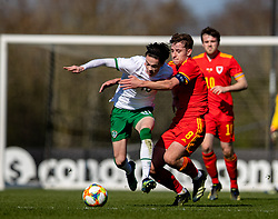 WREXHAM, WALES - Friday, March 26, 2021: Republic of Ireland's Louie Watson (L) gets away from Wales' Terry Taylor during an Under-21 international friendly match between Wales and Republic of Ireland at Colliers Park. Republic of Ireland won 2-1. (Pic by David Rawcliffe/Propaganda)
