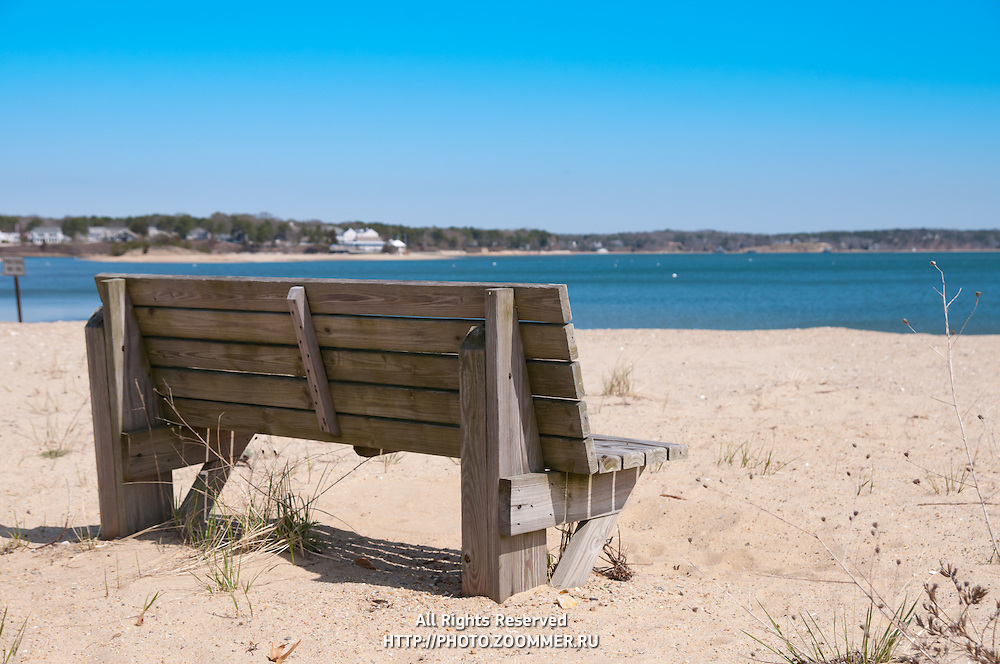 Empty bench in Chatham beach, Cape Cod