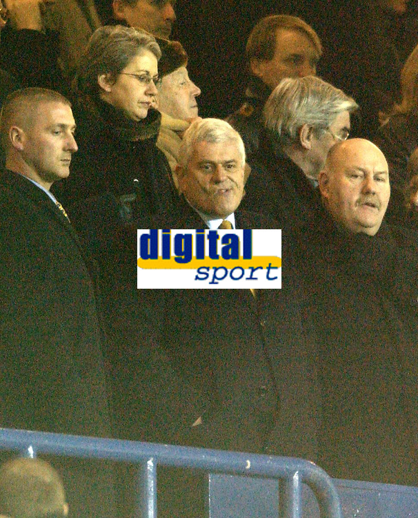 Photo. Jed Wee<br />Leeds United v Gillingham, AXA FA Cup Replay, Elland Road, Leeds. 04/02/2003.<br />Leeds chairman Peter Ridsdale grimaces as he hears some of the fans' comments about him.