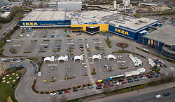 © Licensed to London News Pictures. 01/04/2020. London, UK. Cars queue up to get into a newly opened NHS workers coronavirus testing centre opened in the car park of an IKEA store in Neasden, north London. Death rates from the spread of coronavirus continue to climb. Photo credit: LNP