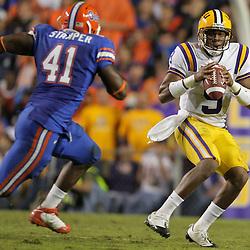 Oct 10, 2009; Baton Rouge, LA, USA; LSU Tigers quarterback Jordan Jefferson (9) is pursued by Florida Gators linebacker Ryan Stamper (41) during a game at Tiger Stadium. Florida defeated LSU 13-3. Mandatory Credit: Derick E. Hingle-US PRESSWIRE