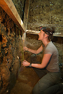 """Kira Westaway collects samples for dating in an excavation pit at Liang Bua cave, discovery site of the Flores """"hobbit, Homo floresiensis"""