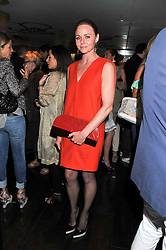 STELLA McCARTNEY at a party to celebrate the launch of Jax Coco - a new soft drink, held at Harvey Nichols 5th Floor Bar, 109-125 Knightsbridge, London on 25th June 2012.