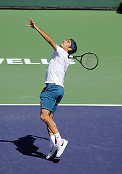 March 15, 2019 - Indian Wells, CA, U.S. - INDIAN WELLS, CA - MARCH 15: Roger Federer (SUI) hits an overhead during the quarterfinals of the BNP Paribas Open on March 15, 2019, at the Indian Wells Tennis Gardens in Indian Wells, CA. (Photo by Adam Davis/Icon Sportswire) (Credit Image: © Adam Davis/Icon SMI via ZUMA Press)