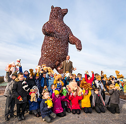 Dunbar, East Lothian, Scotland, United Kingdom, 19 November 2019. Andy Scott statue unveiling: Unveiling today of a 5m high bear sculpture to celebrate the life of naturalist John Muir. The sculpture by the Kelpies creator Andy Scott marks Dunbar-born John Muir who played a key role in the development of national parks in the US. Pictured`: Andy Scott (sculptor) and children from Primary 4 at Dunbar Primary School.<br /> Sally Anderson | EdinburghElitemedia.co.uk
