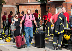 July 26, 2018 - London, London, United Kingdom - West Hampstead fire. ..Neighbors of the block burned seen taking out their belongings. For reasons of security it is not habitable at the moment...About 100 firefighters were sent to Inglewood Road to tackle blaze in top floor of five-storey block of flats...The London Fire Brigade said 15 engines attended the scene in Inglewood Road, West Hampstead, after being called at just after 1am on Thursday. Fifty people were evacuated from the block. No one needed hospital treatment, the London Ambulance Service said. (Credit Image: © Gustavo Valiente/i-Images via ZUMA Press)