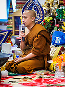 14 APRIL 2019 - DES MOINES, IOWA: A Buddhist monk leads prayers during Lao New Year, also called Songkran,  observances at Wat Lao Buddhavath in Des Moines. Several thousand Lao people live in Des Moines. Most came to the US after the wars in Southeast Asia. Songkran is celebrated in Theravada Buddhist countries (Sri Lanka, Myanmar, Thailand, Laos, and Cambodia) and in Theravada Buddhist communities around the world.      PHOTO BY JACK KURTZ