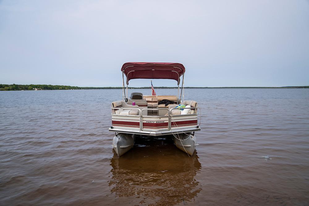 A pontoon boat on Lake Independence at Perkins Park in Big Bay, Michigan.