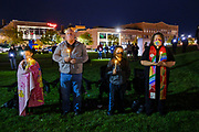 20 SEPTEMBER 2020 - DES MOINES, IOWA: A family with candles at a vigil for US Supreme Court Justice Ruth Bader Ginsburg in Poppajohn Sculpture Park in Des Moines. About 200 people attended the candlelight vigil for Justice Ruth Bader Ginsburg. Ginsburg died from pancreatic cancer on September 18, 2020.      PHOTO BY JACK KURTZ