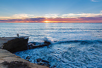 The aptly named Sunset Cliffs in San Diego, California is one of the best places to watch the sun go down as waves crash on the rocks below.
