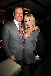 RICHARD DESMOND and JOY CANFIELD at a dinner to celebrate the work of Malaria No More UK held at Hakkasan Mayfair, 17 Bruton Street, London W1 on 16th November 2010.
