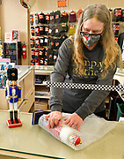 Cheryl Whitaker, an employee of Ben's in downtown Belleville, wraps up nutcrackers for customer Jewel Baker of Belleville on Friday November 27, 2020. <br /> Photo by Tim Vizer
