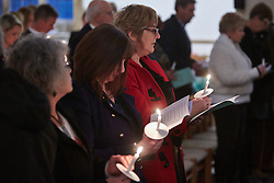 © Licensed to London News Pictures.  17/11/2013. THAME, UK. Members of the congregation sing a hymn during the annual Road Deaths Memorial Service held in St Marys Church, Thame. 78 people were killed in traffic accidents in the Thames Valley Police area last year.   Photo credit: Cliff Hide/LNP