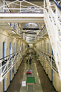 A view down E wing with a pool table and table football in HM Prison Wandsworth, a Category B men's prison at Wandsworth in the London Borough of Wandsworth, South West London, United Kingdom. It is operated by Her Majesty's Prison Service and is one of the largest prisons in the UK with a population over 1500 people. (photo by Andy Aitchison)