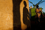 A woman enters the grounds of a hospital in Lira, Uganda. The medical facility is operated by the nonprofit African Youth Initiative Network, or AYINET, which helps victims of the conflict between the Lord's Resistance Army and the Ugandan government in northern Uganda.