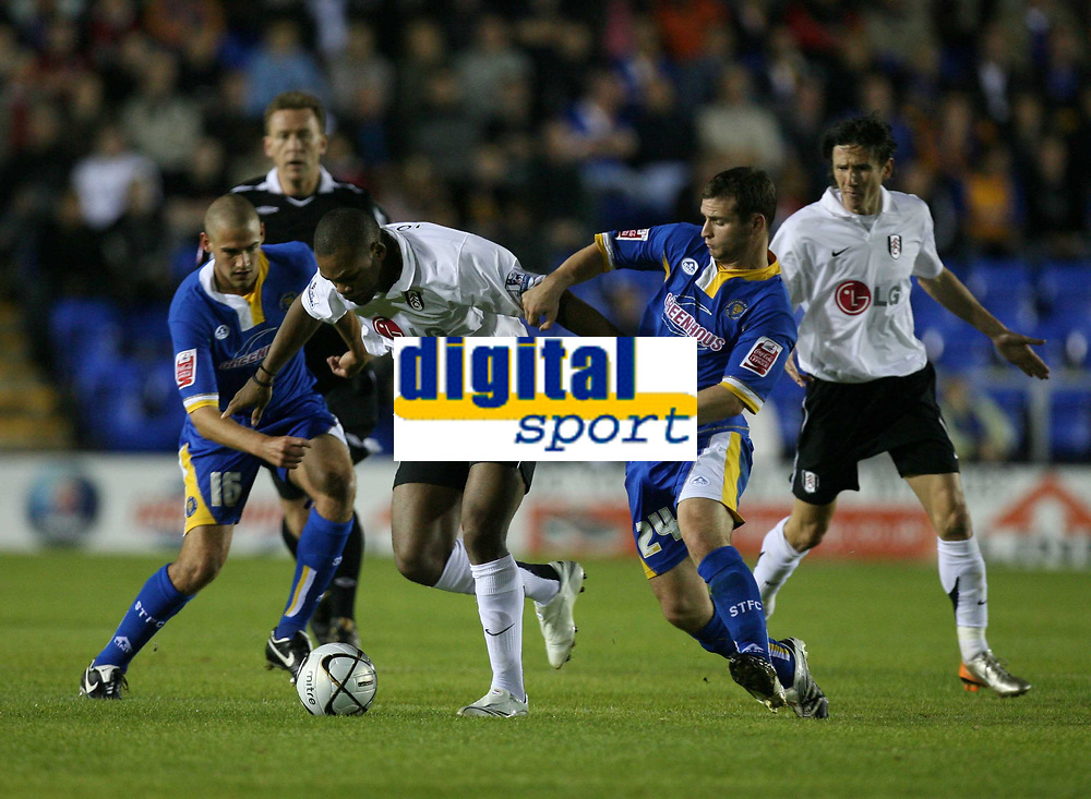 Photo: Rich Eaton.<br /> <br /> Shrewsbury Town v Fulham. Carling Cup. 28/08/2007. Fulham's Collins John (c) tries to squeeze througn the Shrewsbury defence.