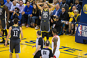 Golden State Warriors guard Stephen Curry (30) reacts to a foul called on him during Game 4 of the Western Conference Finals against the Houston Rockets at Oracle Arena in Oakland, Calif., on May 22, 2018. (Stan Olszewski/Special to S.F. Examiner)