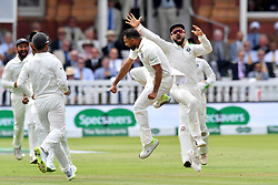 India's Mohammed Shami celebrates taking the wicket of England's Jos Buttler for 24 runs during day three of the Specsavers Second Test match at Lord's, London.