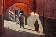 Woman walking in the medina of Marrakech, Morocco.
