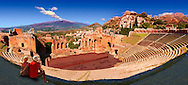 Taormina Greek Ampitheatre with Mount Etna Volcano in the distance, Sicily .<br /> <br /> Visit our SICILY PHOTO COLLECTIONS for more   photos  to download or buy as prints https://funkystock.photoshelter.com/gallery-collection/2b-Pictures-Images-of-Sicily-Photos-of-Sicilian-Historic-Landmark-Sites/C0000qAkj8TXCzro .<br /> <br /> Visit our SICILY HISTORIC PLACES PHOTO COLLECTIONS for more   photos  to download or buy as prints https://funkystock.photoshelter.com/gallery-collection/2b-Pictures-Images-of-Sicily-Photos-of-Sicilian-Historic-Landmark-Sites/C0000qAkj8TXCzro