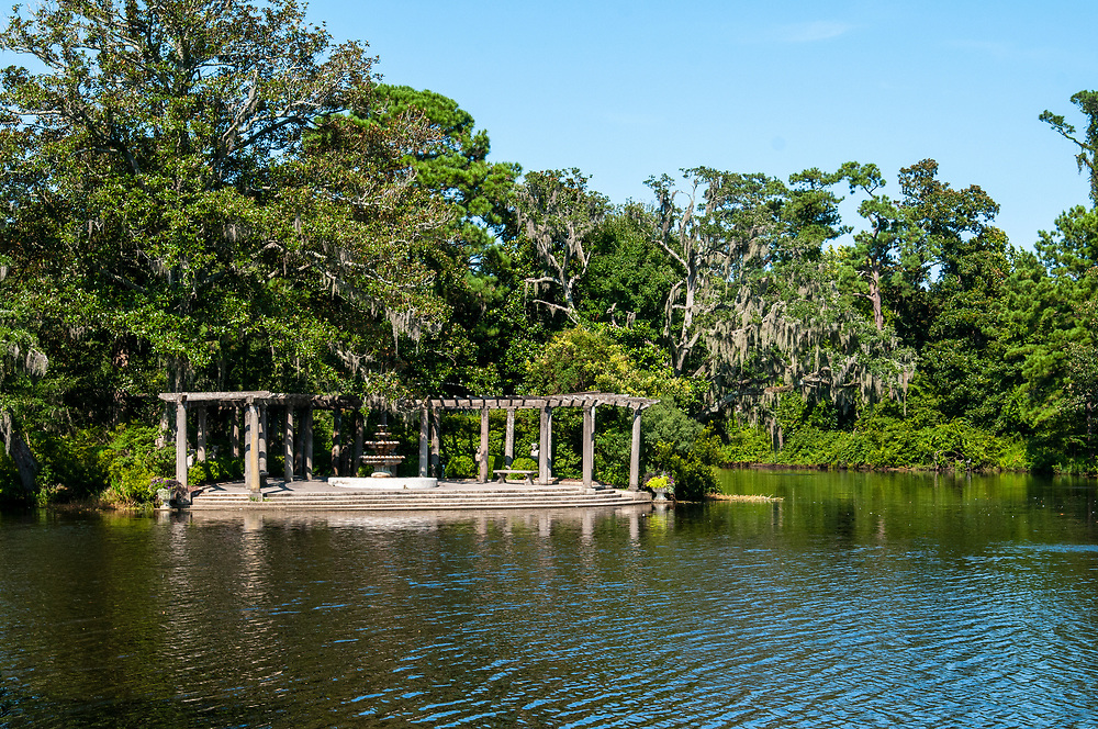 The Pergola Garden on the edge of a small lake at Airlie Gardens in Wilmington, North Carolina on Tuesday, August 10, 2021. Copyright 2021 Jason Barnette