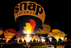 © Licensed to London News Pictures. 07/08/2014; Bristol, UK.  Night-glow at the Bristol International Balloon Fiesta 2014, which is the largest such event in Europe.<br /> Photo credit: Simon Chapman/LNP