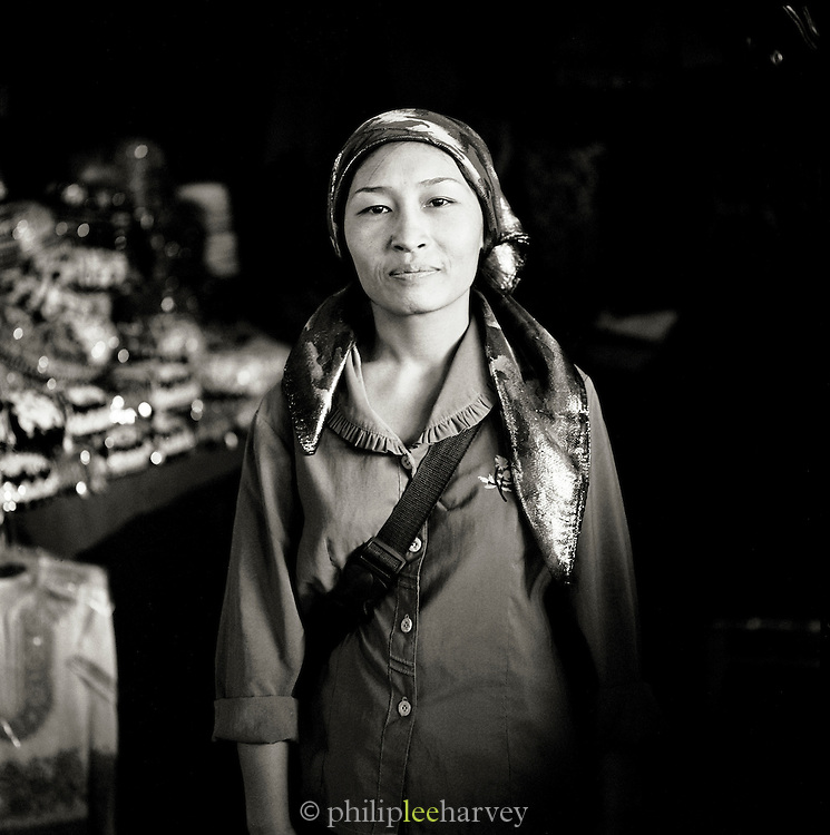 Portrait of a market worker, Silk Route, Turpan, Xinjiang Province, China.