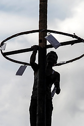 May 1, 2019 - Medan, North Sumatra, Indonesia - Indonesian activists and workers climb areca nut as part of commemorating Labor Day or International Labor Day in Medan on May 1 2019. But on the other hand, workers are celebrating 2019 Labor Day with areca climbing events and traditional competitions for prizes, of which thousands workers gather to participate in celebrating Labor Day. (Credit Image: © Albert Ivan Damanik/ZUMA Wire)