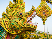 "31 MARCH 2015 - BANGKOK, THAILAND: A naga, or mythical serpent, on a float that will be in a parade for Princess Maha Chakri Sirindhorn, born 2 April 1955, the second daughter of King Bhumibol Adulyadej. Thais commonly refer to her by reducing such title to ""Phra Thep"", meaning ""princess angel"". Her title in Thai is the female equivalent of the title held by her brother, Crown Prince Maha Vajiralongkorn. The Thai constitution was altered in 1974 to allow for female succession, thus making her eligible for the throne.   PHOTO BY JACK KURTZ"