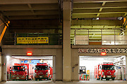 Tokyo Fire Department fire engines in a fire station under the arches of the expressway overpass that snakes through Tokyo. Roppongi, Tokyo, Japan. Friday November 14th 2014